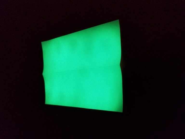 Charged Atomic Glow in Green